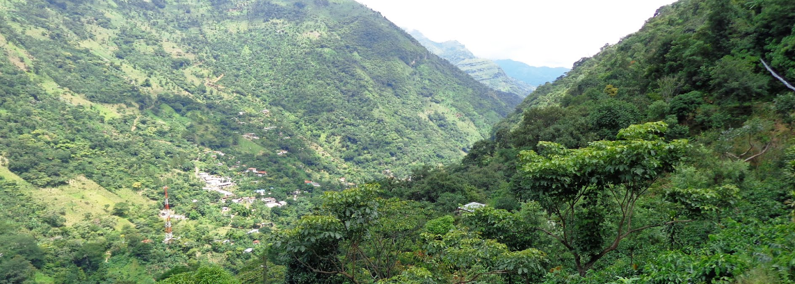 Bob LaGarde - Road trip through Central America - Looking down on a village far below in the valley approaching Huehuetenango