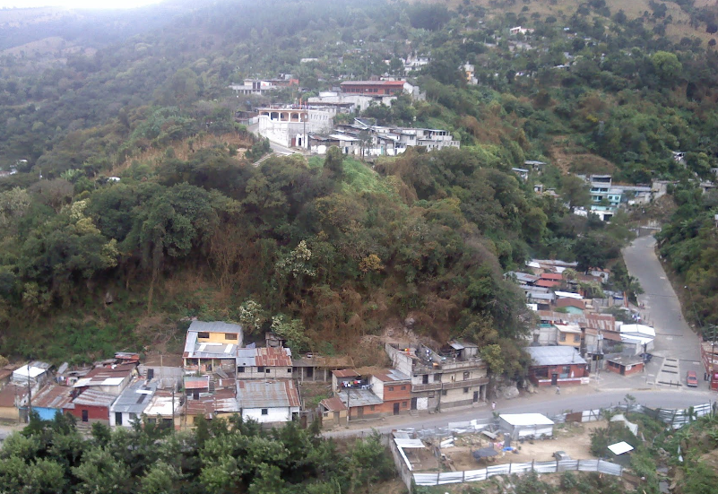 Bob LaGarde - Road trip through Central America - Contrast of development on hillside overlooking valley of shanty houses near El Tizate