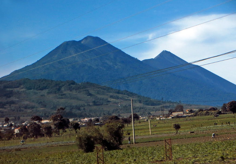 Bob LaGarde - Road trip through Central America - Trio of volcanos as seen from Patzicia, Guatemala